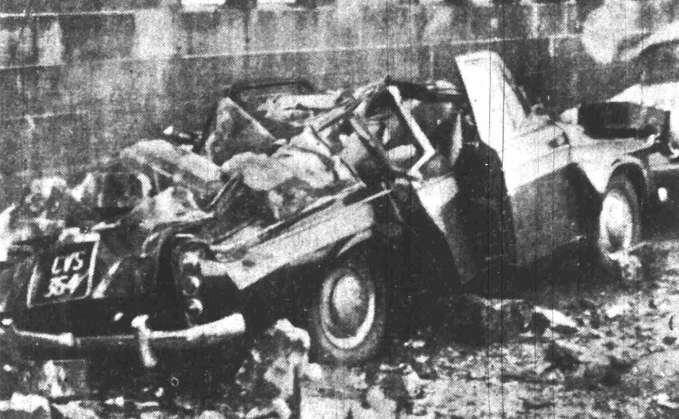 An image of a car crushed by falling masonry in Glasgow