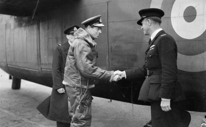 A photograph of The Duke of Kent shaking hands with the pilot of the aircraft taking him from Prestwick to Canada  - the first time a member of the Royal Family crossed the Atlantic by aircraft.