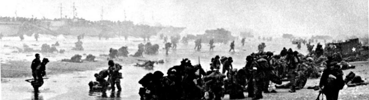A photograph of British soldiers on a Normandy beach on D-Day, 1944.