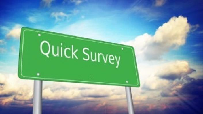 An image of a roadside style sign which reads 'Quick Survey'