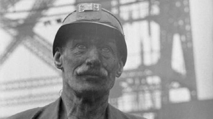 A photograph of a miner