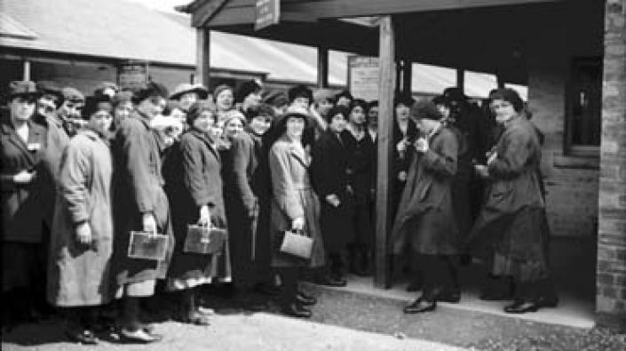 Photograph of female workers at the checking in point at HM Munitions Factory Gretna