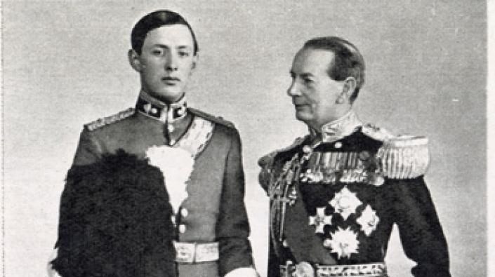 A photograph of Admiral of the Fleet Sir Roger Keyes with his son Geoffrey in the full dress uniform of a subaltern in the Royal Scots Greys.